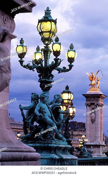 France, Paris, Pont Alexandre III, ornate lamp posts