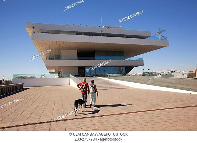 Couple with a dog in front of the Veles e Vents, building by David Chipperfield, Port Americas Cup, Valencia, Spain, Europe