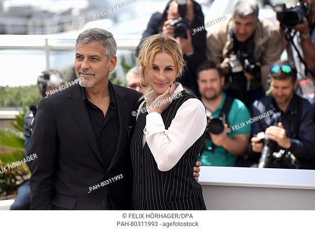 US actor George Clooney and US actress Julia Roberts attends at the photocall for 'Money Monster' at the 69th Annual Cannes Film Festival at Palais des...