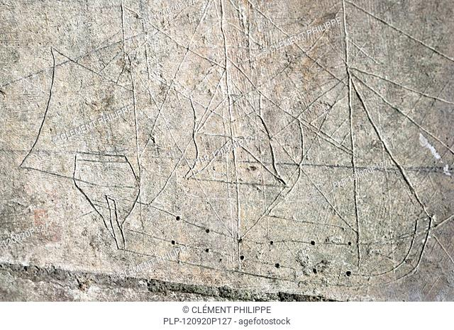 Old graffiti of galleon sailing ship carved on rampart wall of the citadel at Brouage / Hiers-Brouage, Charente-Maritime, France