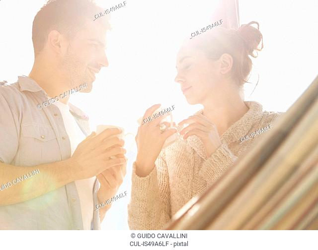 Young couple drinking cups of coffee