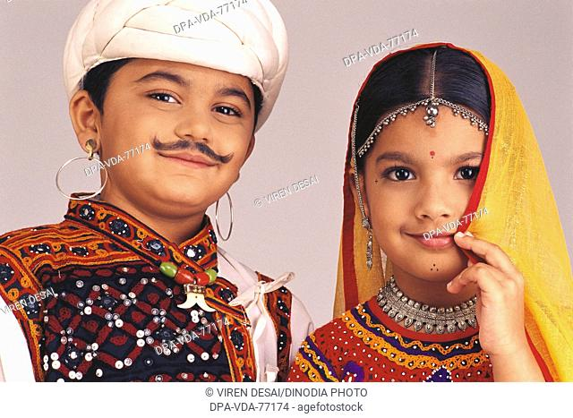 3f35d26ec Children dressed as Gujarati Couple ; boy and girl Wearing Traditional  Rural costume ; Mid Shot