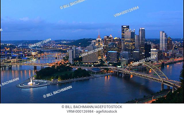 Pittsburgh Pennsylvania skyline from Mt Washington of downtown city and rivers at Golden Triangle at night exposure of Three Rivers and fountain at point