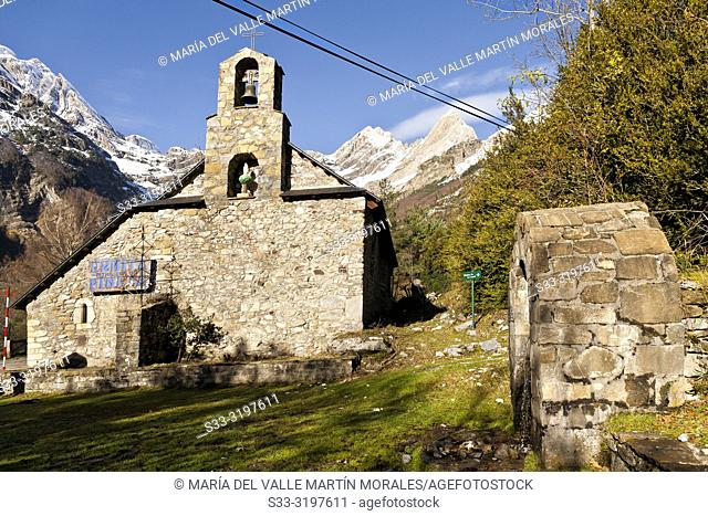 Pineta hermitage and snow at Pineta Circus on the background. Huesca. Aragon. Spain. Europe