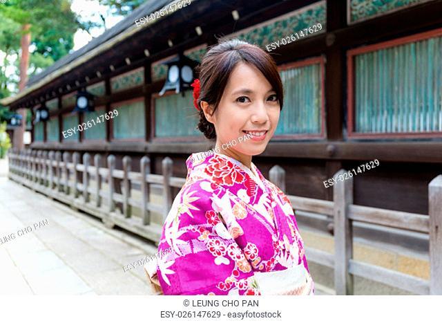 Japanese Woman wearing the kimono dress at temple