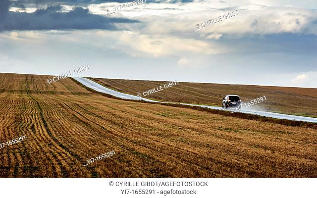 Car driving on country road after a storm, Marne, Champagne Ardennes region, France