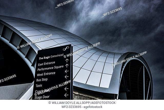 The Sage Gateshead under a stormy sky