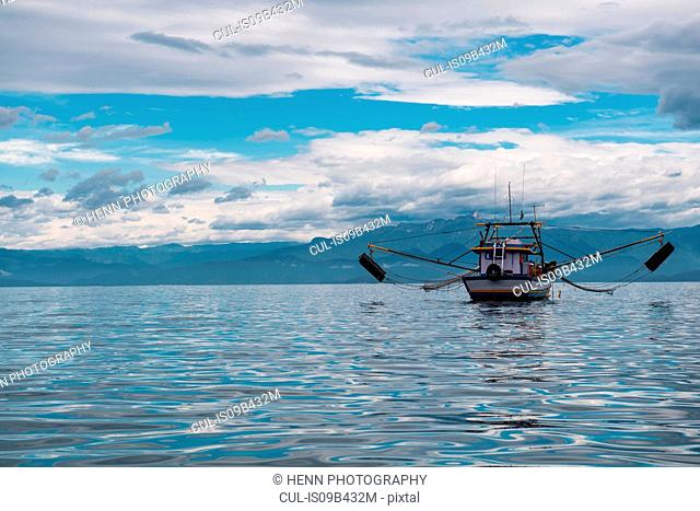 Fishing boat in a calm bay, Ilha Grande, Rio de Janeiro, Brazil