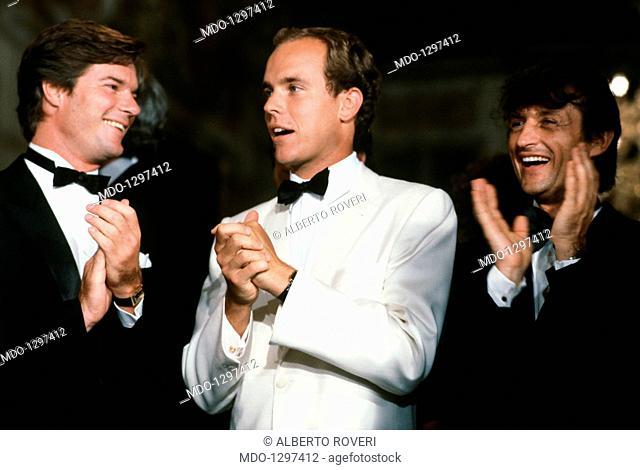 Albert of Monaco, Matthew Modine and Tony Renis at Venice Film Festival. Prince Albert of Monaco at the XL Venice Film Festival applauds with Matthew Modine and...