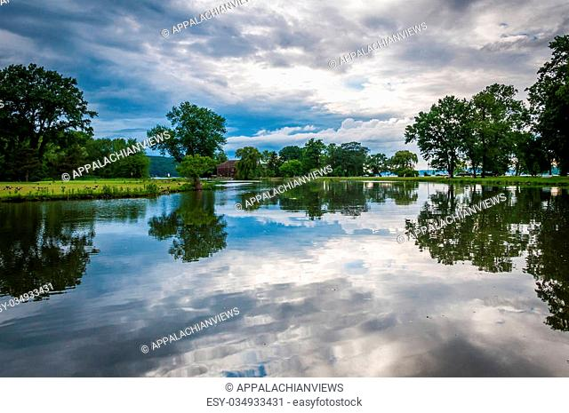 Storm clouds reflecting in a pond at Stewart Park in Ithaca, New York