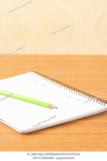 Blank notebook and pencil. Conceptual image of office work or education