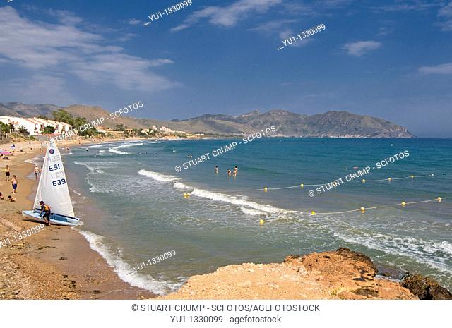 Sailboat on the shoreline at Isla Plana, Cartagena in the Region of Murcia, South Eastern Spain