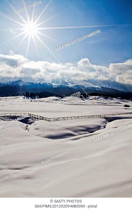 Snow covered landscape with mountain range in the background, Kashmir, Jammu And Kashmir, India