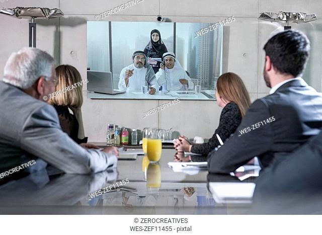 Business people in video conference with clients from the Middle East