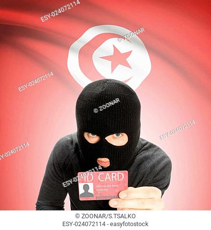 Hacker with flag on background holding ID card in hand - Tunisia
