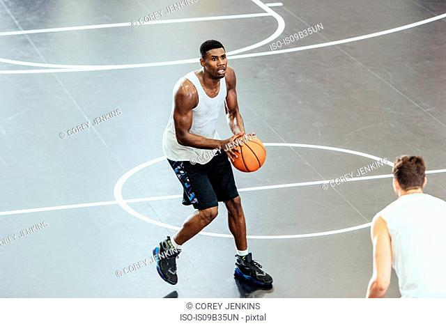 Male basketball player preparing aim on basketball court