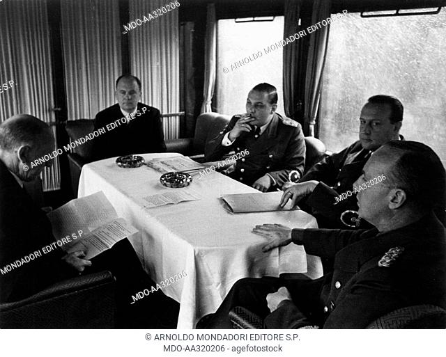 Joachim von Ribbentrop and other German politicians during a meeting in Berlin. The German Foreign Minister Joachim von Ribbentrop listening to the reading of a...