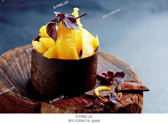 Orange fillets in a chocolate cup