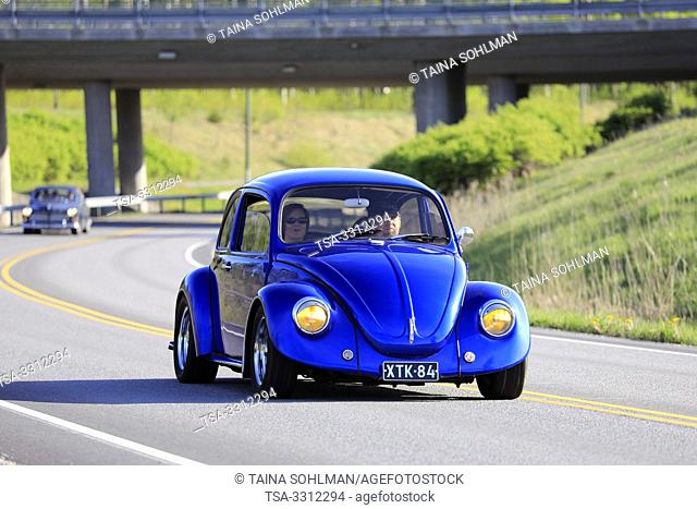 Salo, Finland. May 18, 2019. Classic royal blue 1970s Volkswagen Beetle, or Type 1 on road on the popular annual event Salon Maisema Cruising 2019