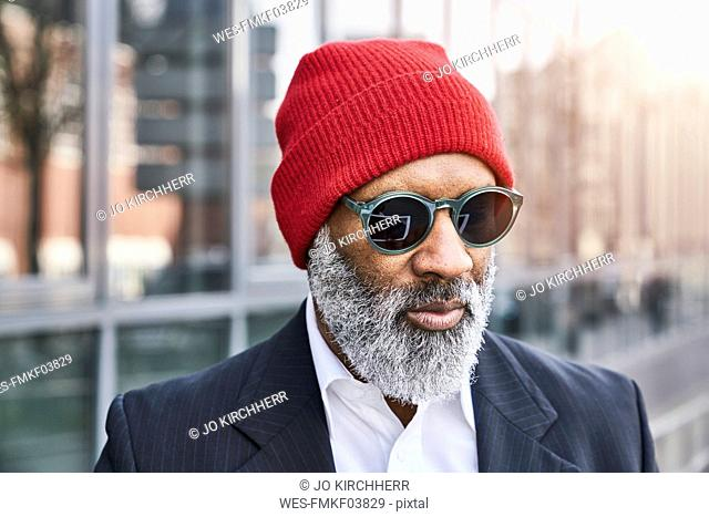 Mature businessman wearing red cap