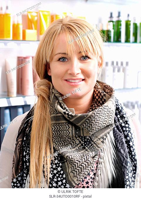 Woman standing in hair salon