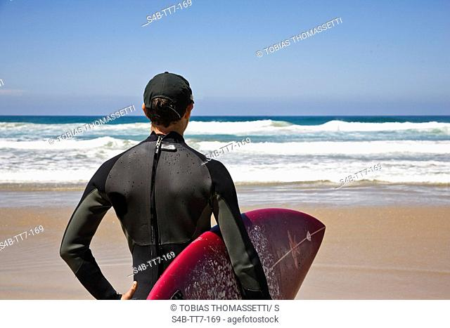 Surfer with bodyboard on beach, Surf Coast Shire, Victoria, Australia