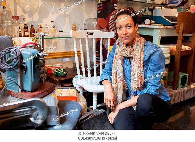 Portrait of young woman in vintage shop