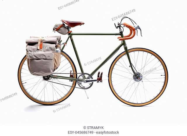 Vintage green road bicycle isolated on white