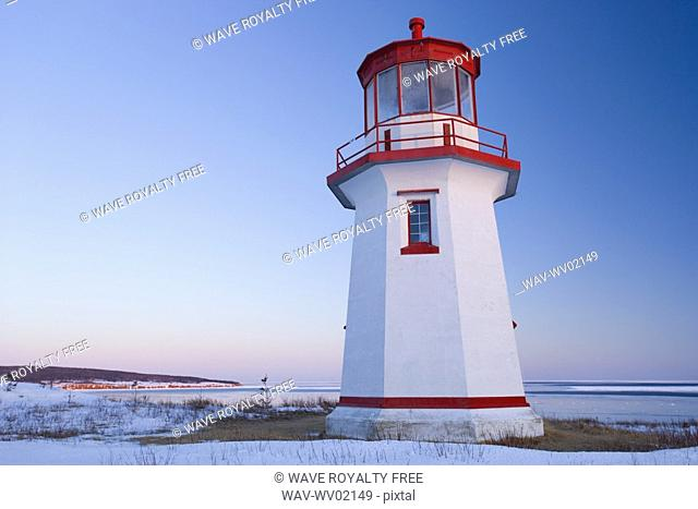 View of Cap Blanc lighthouse and Île Bonaventure at sunset, Quebec