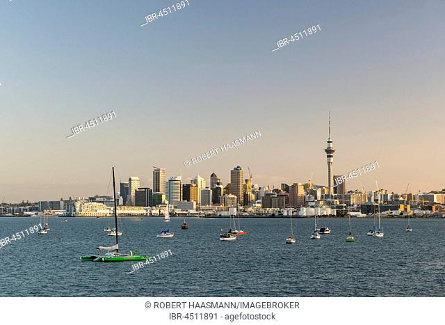 Auckland skyline with Sky Tower, boats anchoring in the sea, North Island, New Zealand