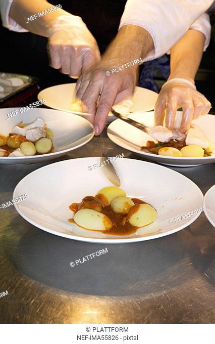 A cook preparing food in a restaurant kitchen Sweden