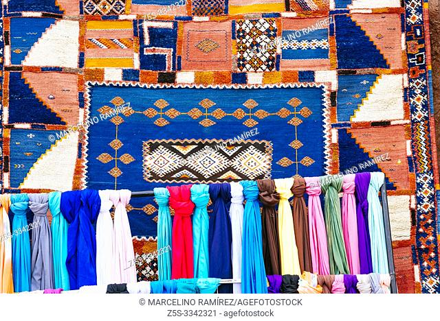 Scarves and traditional Moroccan carpets in a store in Ouarzazate, Drâa-Tafilalet, Morocco, North Africa