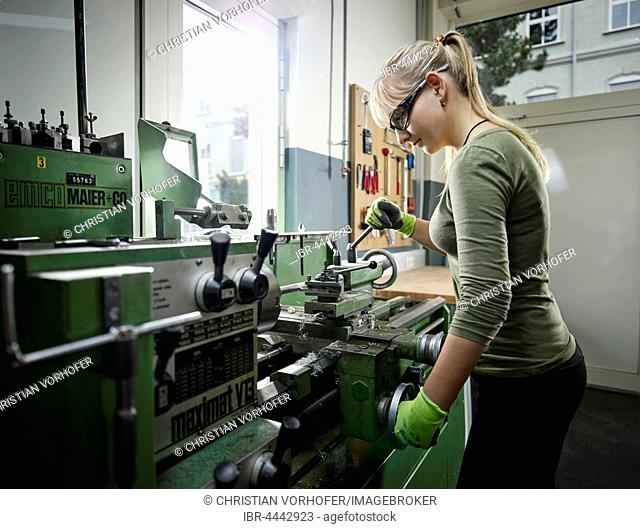 Young woman working on lathe, Metalwork, training