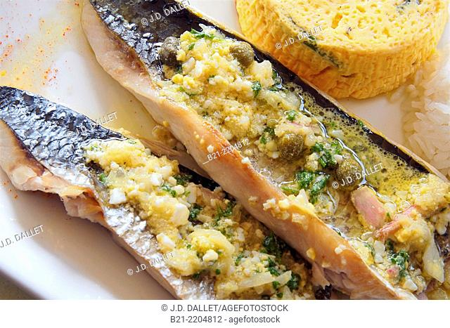 Sea bass with 'persillade au fromage' (chopped parsley and garlic with cheese), France