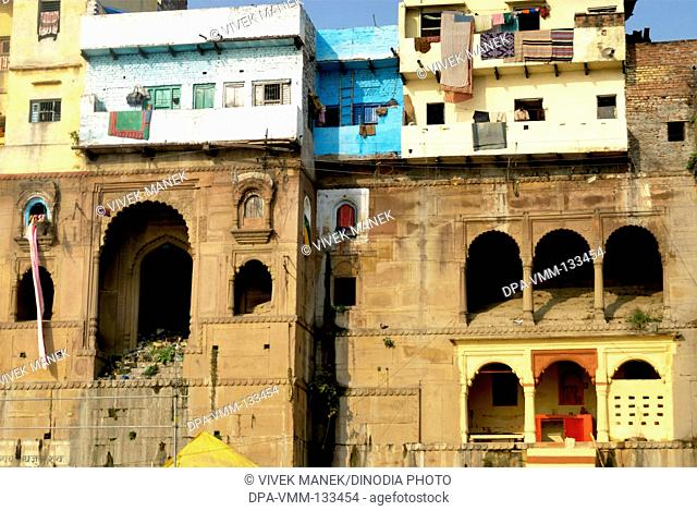 Houses on ghat of holy Ganga river ; Varanasi ; Uttar Pradesh ; India