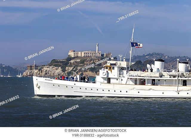 USS Potomac (AG-25) - Franklin Delano Roosevelt's yacht, launched 1934, sails past Alcatraz Prison in San Francisco Bay, California, USA