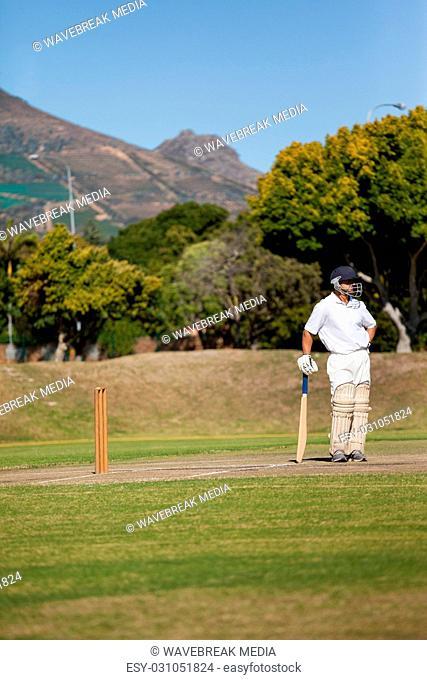 Full length of batsman standing on field during match