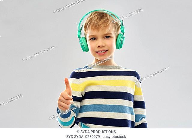 boy in headphones showing thumbs up