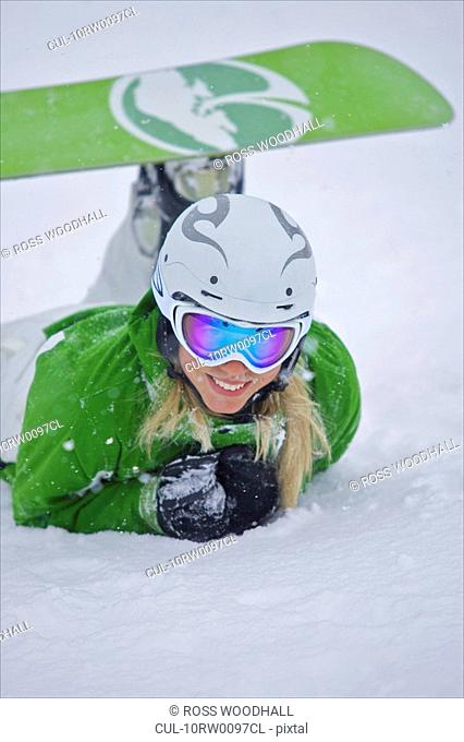Snowboarder lying in the snow