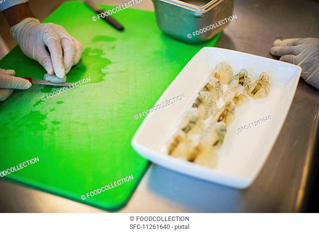 Prawns being cut into a butterfly shape
