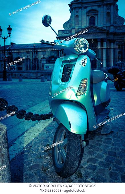 Old motor scooter parked on a Parisian street