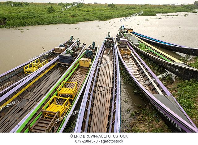 Boats parked near land in Inle Lake, Myanmar
