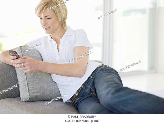 Woman text messaging on cell phone