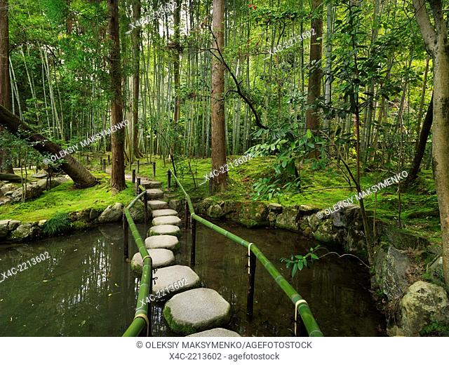 Japanese Zen garden with stepping stones over a pond. Kyoto, Japan