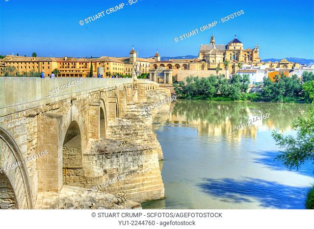 HDR of the Roman Bridge with the Cathedral–Mosque of Córdoba in the background across the Guadalquivir River, Córdoba, Andalusia, Spain,
