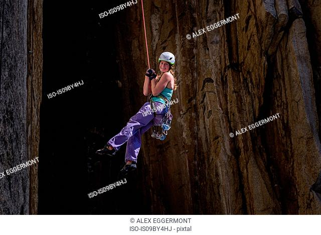 Climber rock climbing, Cookie Cliff, Yosemite National Park, California, United States