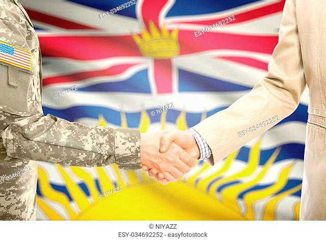 American soldier in uniform and civil man in suit shaking hands with Canadian province flag on background - British Columbia