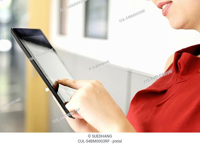 Close up of woman using tablet computer