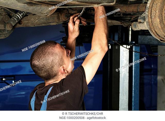 Mechanist Repairing a Car