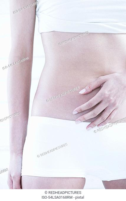 Woman?s hand covering her belly